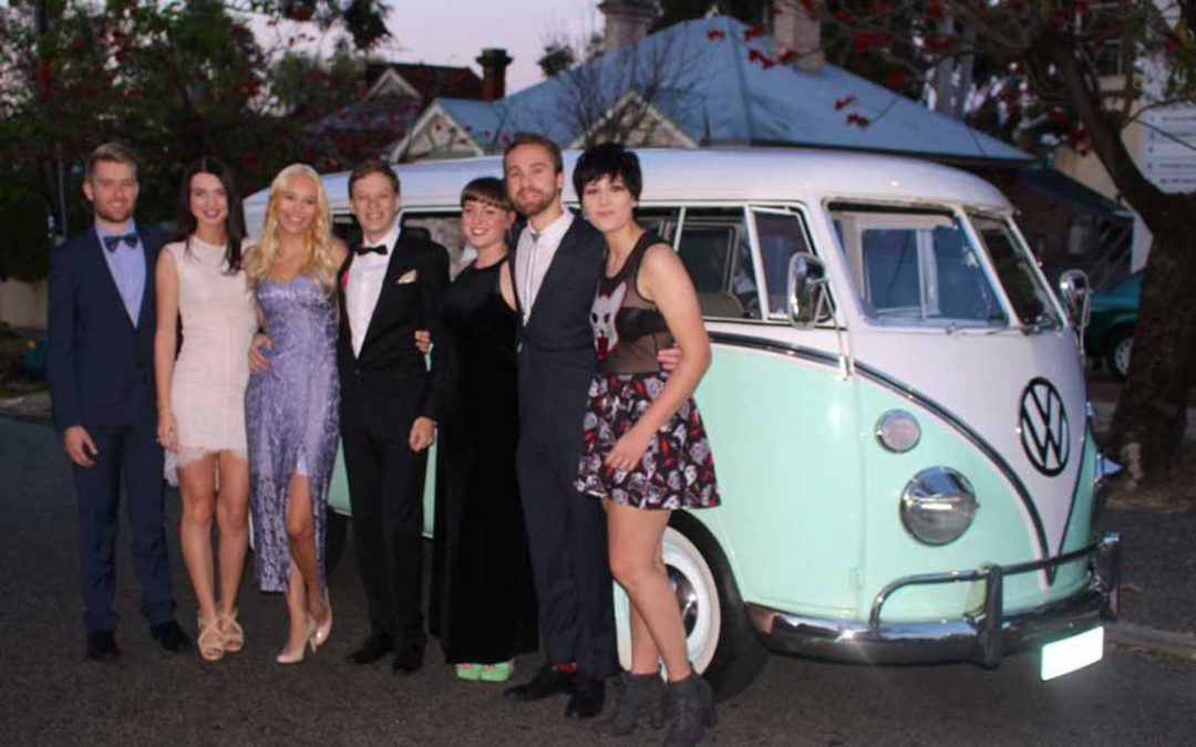 Students in their formal outfits in front of a Kombi