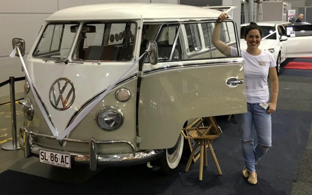 Kombi at wedding expo with a woman standing next to the open passenger door